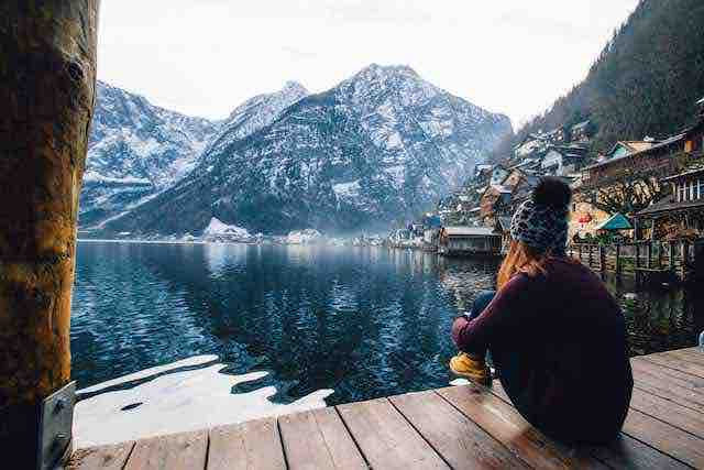 woman in front of lake